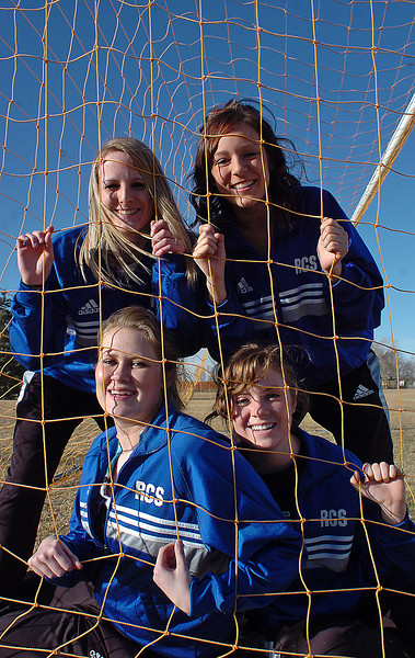 Ressurection Christian School soccer senior soccer players pose for a photo Thursday at Kroh Park in Loveland. Clockwise from bottom left they are Abby Yount, Audrey Isabelle, Alyssa Parrott and Courtney Brand.