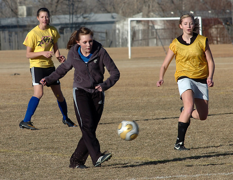 Ressurection Christian soccer players practice Thursday at Kroh Park. From left they are Sara Wallman, Elesha Hummel and Allison Weaver.