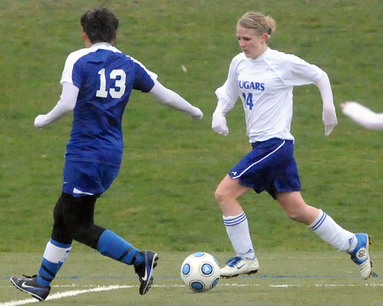 Resurrection Christian School's Courtney Brand, right, attempts to get around Evangelical Christian Academy's Claire Rice in the second half of their game on Tuesday, May 11, 2010 at the Loveland Sports Park.