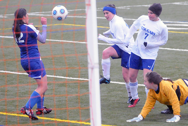 Resurrection Christian School's Nicole Stevenson, center, tries to get the ball past Evangelical Christian Academy's Alyssa Edwards, left, and goalie Kim Schipper as Charlotte Goheen looks on in the second half of their game on Tuesday, May 11, 2010 at the Loveland Sports Park.