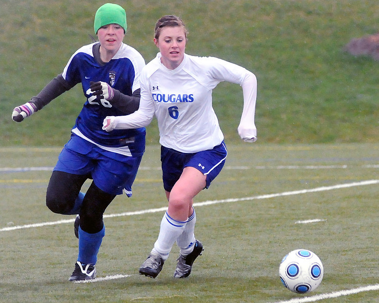 Resurrection Christian School's Audrey Isabelle, right, tracks down the ball in front of Evangelical Christian Academy's Carolyn Schipper in the second half of their game on Tuesday, May 11, 2010 at the Loveland Sports Park.