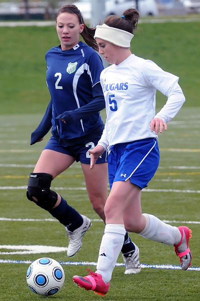 Resurrection Christian School junior Nicole Stevenson, right, dribbles around Academy's Danielle Hasse in the first half of their match Wednesday at the Loveland Sports Park.
