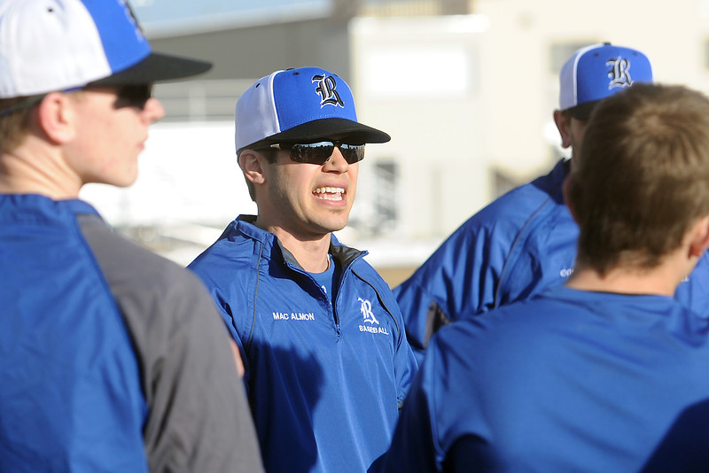 Resurrection Christian School head baseball coach Grant MacAlmon, middle, talks to his players during practice Wednesday, March 6, 2013 at the school.