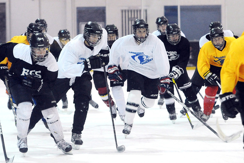 Resurrection Christian School hockey players skate laps together around the ice inbetween drills during practice on Tuesday, Nov. 27, 2012 at the NoCo Ice Center in Windsor.