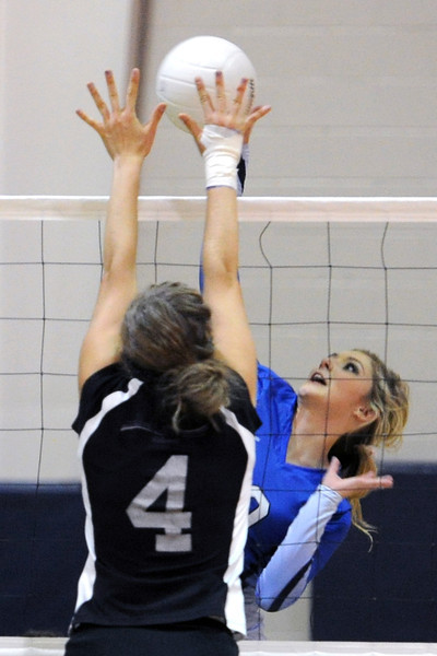 Resurrection Christian School sophomore Jenniofer Lohr, right, goes up at the net against Front Range Christian's Taya Hanna during their match Tuesday, Sept. 18, 2012 at RCS.