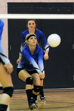 Resurrection Christian School senior Riliegh Lienemann, front, bumps a serve while teammate Carly Whitham looks on during their match against Front Range Christian on Tuesday, Sept. 18, 2012 at RCS.
