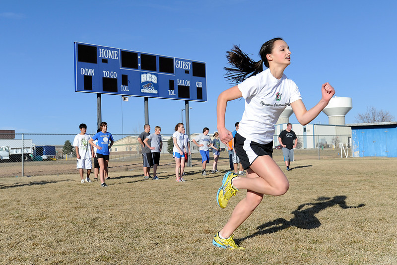 Resurrection Christian School freshman Madison Webb, front, runs warm-up sprints on the football field with her track and field teammates at the start of practice on Tuesday, March 6, 2012.