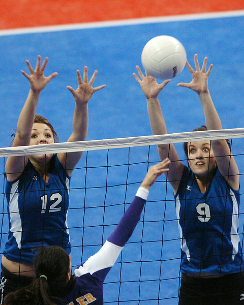 Resurrection Christian School's Rachel Perry, left, and Jordyn Kohles go up for a block in game two of their match against Fowler in the finals of the Class 2A State Volleyball Championships on Saturday, Nov. 14, 2009 at the Denver Coliseum.