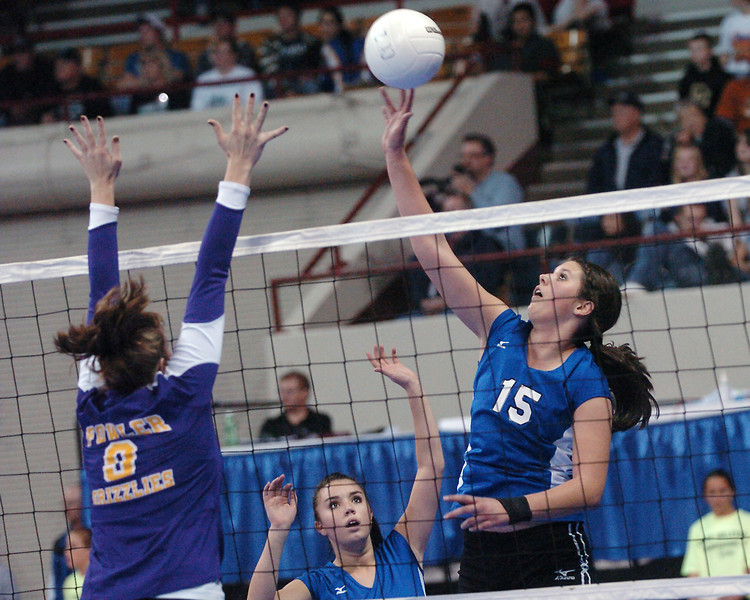 Resurrection Christian School senior Anna Dewald goes up for the ball while teammate Julia Karlin looks on during game one of their match against Fowler in the finals of the Class 2A State Volleyball Championships on Saturday, Nov. 14, 2009 at the Denver Coliseum.