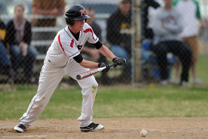 Roosevelt High School's Derick White lays down a sacrifice bunt in the top of the sixth inning of a game against Thompson Valley on Tuesday, April 17, 2012 at Constantz Field.