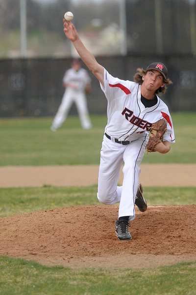 Roosevelt High School's Mason Reinick throws a pitch in the bottom of the fifth inning of a game against Thompson Valley on Tuesday, April 17, 2012 at Constantz Field.