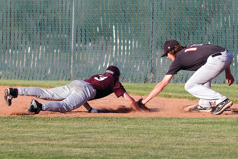 Legion Post 70 first baseman Mason Reinick puts the tag on Berthoud's Mike McInerney on a pick off play in the top of the fifth inning of their game Wednesday at Roosevelt High School.