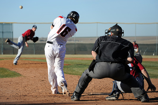 Roosevelt High School's Mack Morford (16) hits a walk-off grand slam in the bottom of the fifth inning of a game against Northridge on Thursday, March 22, 2012 at RoughRider Ballpark.