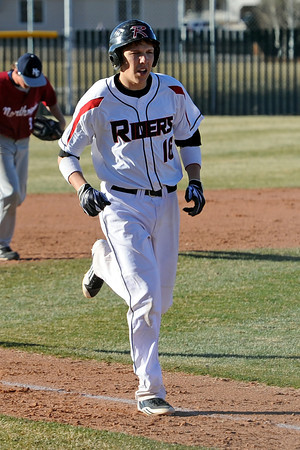 Roosevelt High School's Mack Morford trots down the third-base line toward home plate after hitting a game-ending grand slam in the bottom of the fifth inning of a game against Northridge on Thursday, March 22, 2012 at RoughRider Ballpark.