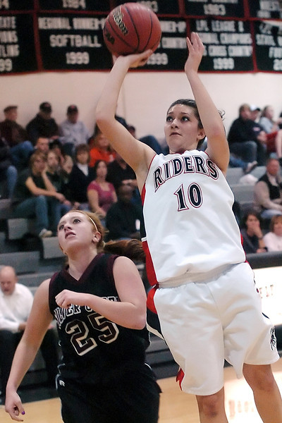 Roosevelt High School senior Kaylee Longoria takes a shot over Silver Creek's Amanda Apodaca in the first quarter of their game Friday, Dec. 4, 2009 at RHS.