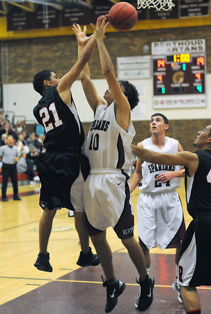 Roosevelt High School's Jordan Grado, left, and Berthoud's Joshua Krokowski go up for a rebound while Fily Perez, right, and Gregory Hutchins look on in the first quarter of their game on Wednesday, Dec. 8, 2010 at BHS. Roosevelt won, 74-45.