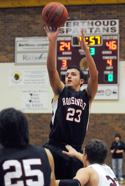 Roosevelt High School senior Sam Hardy (23) takes a shot over Berthoud's Zachary Ruebesam while Alejandro Dominguez (25) looks on in the third quarter of their game on Wednesday, Dec. 8, 2010 at BHS. Roosevelt won, 74-45.