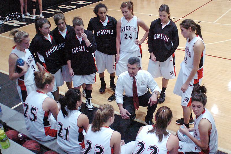 Roosevelt High School girls basketball head coach Randy Longoria, center, talks to his players during a timeout of their game against Thompson Valley on Tuesday at RHS.