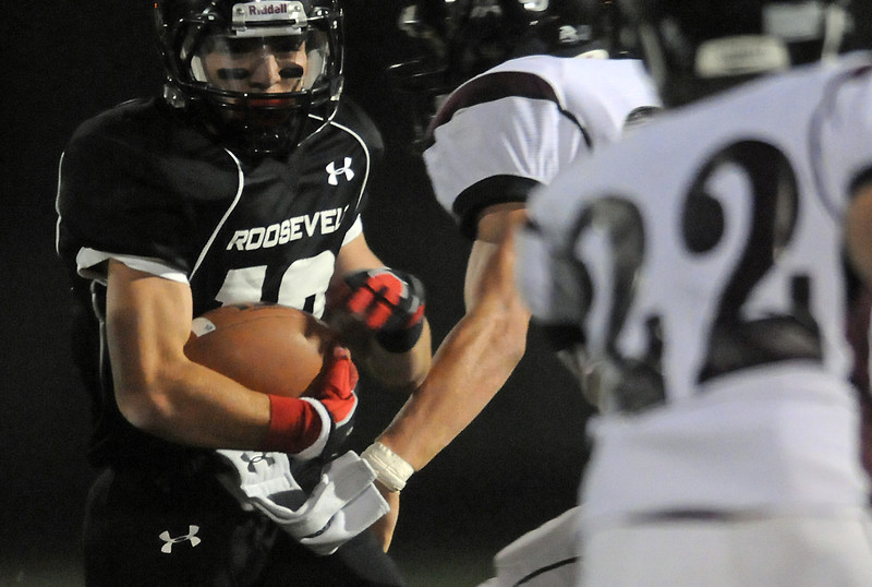 Roosevelt High School's Marcus Holguin looks for running room in the first quarter of a game against Silver Creek on Friday at Peterson Stadium in Johnstown.