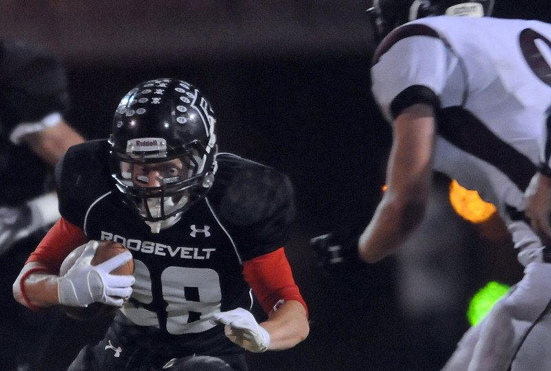 Roosevelt High School's Christian Kratz looks for running room in the first quarter of a game against Silver Creek on Friday at Peterson Stadium in Johnstown.