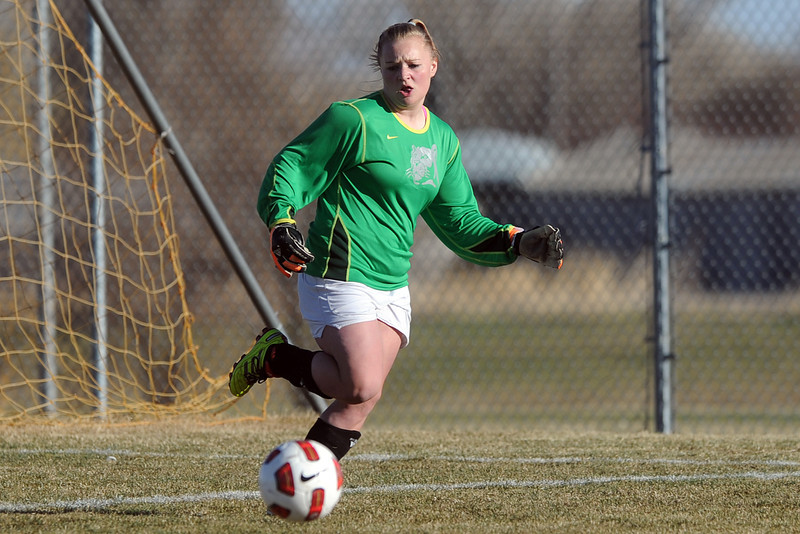 Mountain View High School goalie Shilee Calhoun tracks down the ball during a game against Roosevelt on Wednesday, March 21, 2012 at MVHS.