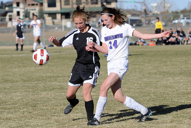 Mountain View High School's Leigh McDonald, right, collides with Roosevelt's Shawnda Eurich as they chase after the ball during their game Wednesday, March 21, 2012 at MVHS.
