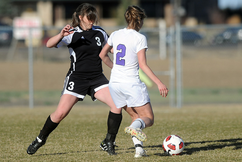 Roosevelt High School junior Sydney Jacox, left, and Mountain View's Kristen Barkman battle for control of the ball in the second half of their game Wednesday, March 21, 2012 at MVHS.