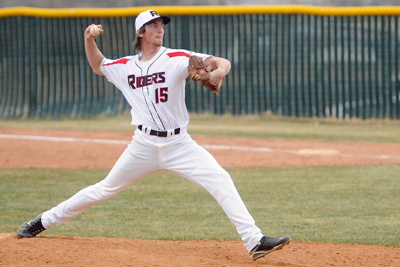 Roosevelt High School's Mason Reinick winds up to throw a pitch in the top of the seventh inning of a game against Mead on Saturday, March 30, 2013 at RHS.