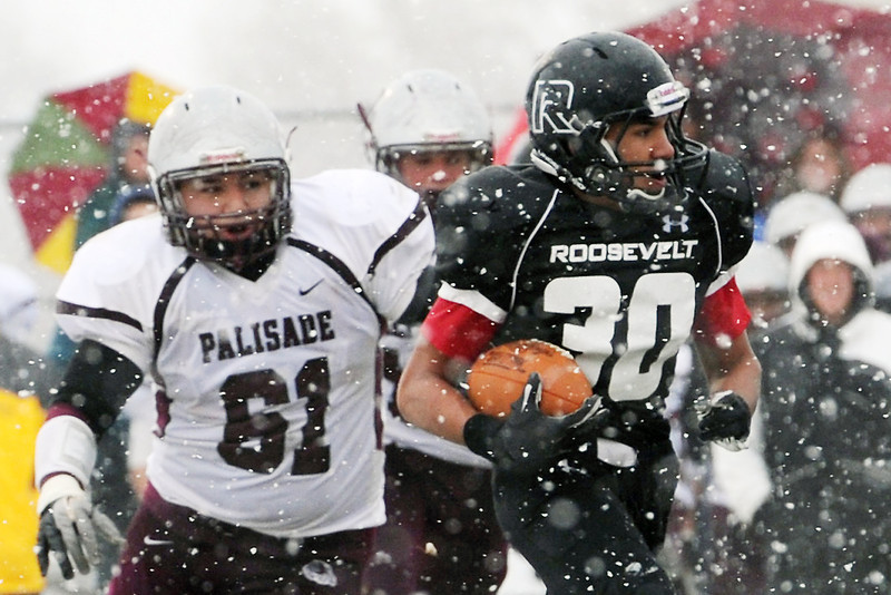 Roosevelt High School running back Randy Molinar (30) is pursued by Palisade defender Armando Cabriales (61) during a run play in the second quarter of their game on Saturday, Nov. 10, 2012 at Peterson Field.
