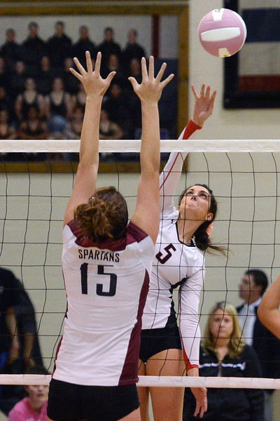 Roosevelt High School's Hannah Eining (5) goes up at the net against Berthoud's  Sara Nienaber during set one of their match on Tuesday, Oct. 9, 2012 at RHS. The RoughRiders won, 3-1.