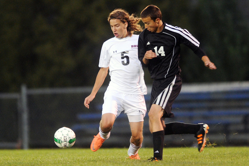 Berthoud High School's Kurt Hucal, left, and Michael Kellogg of Roosevelt battle for control of the ball in the first half of their match on Wednesday, Sept. 12, 2012 at Marr Field.