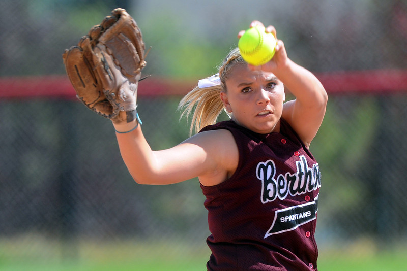 Berthoud High School's Victoria Puchino winds up before throwing a pitch in the bottom of the second inning of a game against Roosevelt on Saturday, Sept. 22, 2012 at Nelson Farm Park in Johnstown.