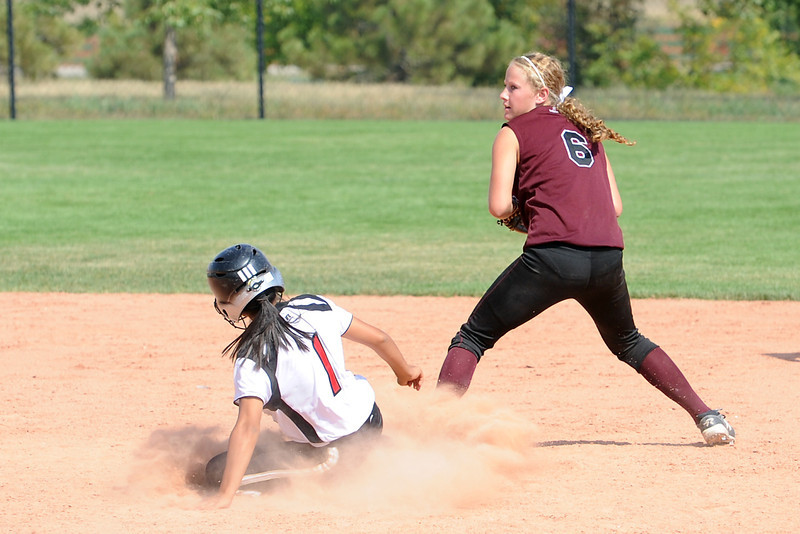 Roosevelt High School's Monica Ramirez (1) is forced out at second base by Berthoud's Kendall Baker during their game on Saturday, Sept. 22, 2012 at Nelson Farm Park in Johnstown.