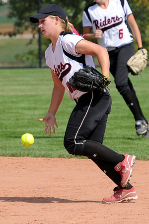 Roosevelt High School shortstop Madie Kilcrease flips the ball toward the pitcher's mound after catching a fly ball to end the inning during a game against Berthoud on Sept. 22, 2012 at Nelson Farm Park in Johnstown.