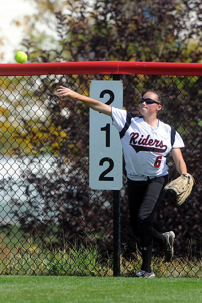 Roosevelt High School left fielder Cheyenne Wells throws the ball in after fielding a hit in the top of the sixth inning of a game against Berthoud on Saturday, Sept. 22, 2012 at Nelson Farm Park in Johnstown.