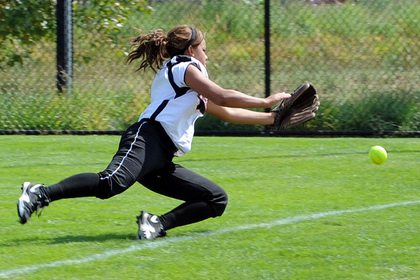 Roosevelt High School right fielder C. Tate makes a diving attempt at a foul ball hit in the top of the fifth inning of a game against Berthoud on Saturday, Sept. 22, 2012 at Nelson Farm Park in Johnstown.