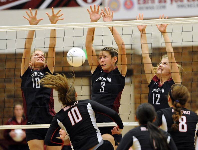 Berthoud High's #10 Hannah Atkinson, #3 Ashley Lozinski, and #12 Alyssa Peacock uring a game against Roosevelt High in Berthoud Thursday, September 13, 2012.