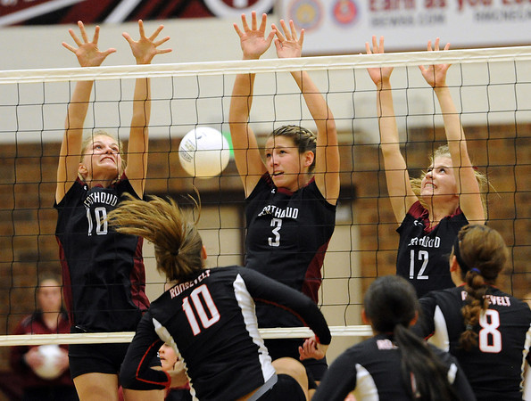 Berthoud High's #10 Hannah Atkinson, #3 Ashley Lozinski, and #12 Alyssa Peacock uring a game against Roosevelt High in Berthoud Thursday, September 13, 2012.