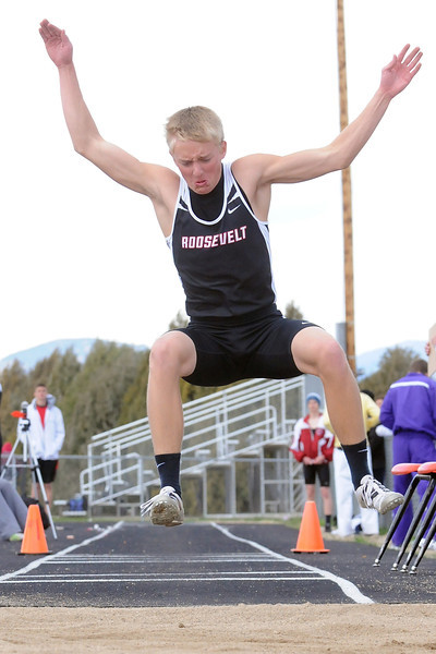 Roosevelt High School sophomore Isaac Krey competes in the triple jump during the Berthoud Invitational track meet on Saturday.