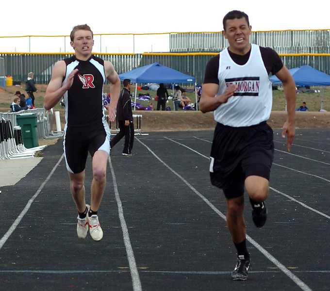 Roosevelt High's Remmington Reinick, left, tries to catch his competition Monday during the boys 400 event at a track meet at Roosevelt High.