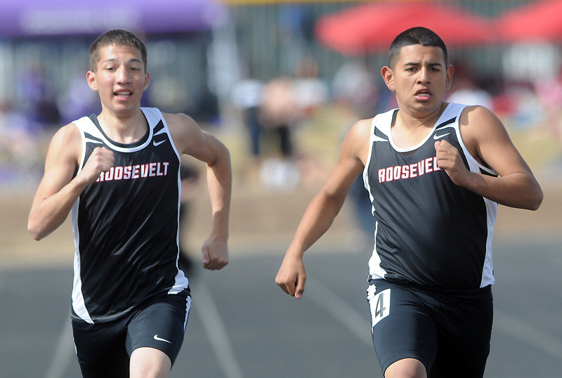 Roosevelt High School's Huver Lira, left, and Luis Calzada run side-by-side during a heat of the 200-yard run at the Randall Hess Invitational on Saturday in Johnstown.