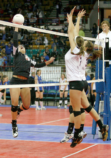 Erin Seele pikes the ball against Cheyenne Mountain on Friday at the Denver Coliseum. (Photo by Gabriel Christus)