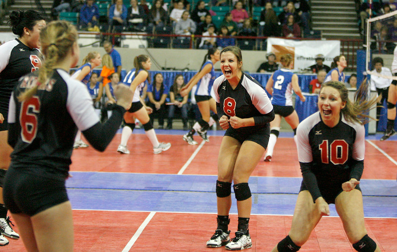 Roosevelt's Erin Seele (8) and Kylee Placke (10) celebrate with their team after winning the first set against Cheyenne Mountain during 4A Volleyball State Championships on Friday at The Denver Coliseum. Roosevelt lost the match 4-1. (Photo by Gabriel Christus)