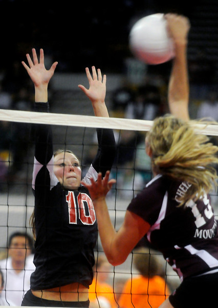 Kylee Placke, left, of Roosevelt High School, attempts a block during her team's Colorado State Finals loss to three-time champion Cheyenne Mountain on Saturday night at the Denver Coliseum.