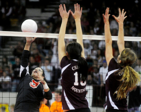 RoughRiders senior Sami Fuentes attempts a kill during her teams loss the Cheyenne Mountain in the Colorado State Finals at the Denver Coliseum on Saturday night.