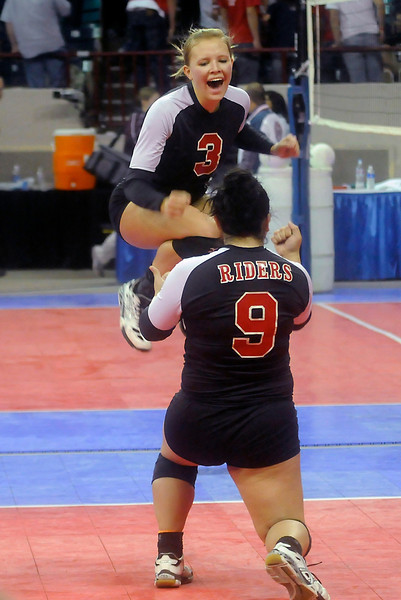 Roosevelt High School teammates Mackenzie Krause, left, and Sami Fuentes celebrate a point during their teams come from behind semi final victory over Eagle Valley High School. Despite dropping the first two games, the RoughRiders stormed back to win the next three to advance to the 4A finals.