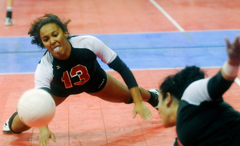Roosevelt High School senior Chantel Washington attempts a dig during the RoughRiders' semifinal victory over Eagle Valley High School at the Denver Coliseum on Saturday afternoon.