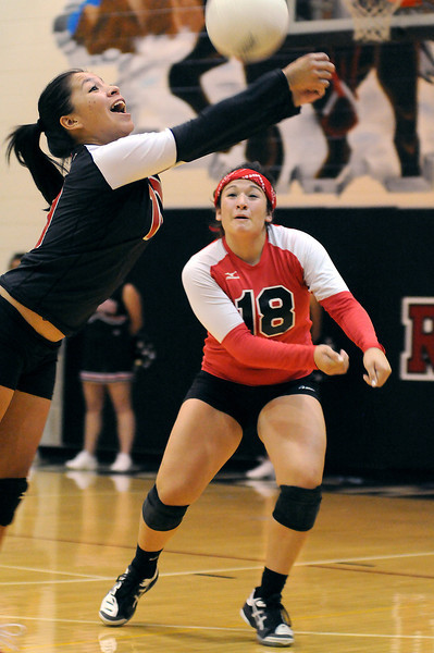Roosevelt High School sophomore Gabby Ramirez bumps the ball as her teammate Sami Fuentes backs her up during the third game of Thursday night's match at Roosevelt High School. Roosevelt won the match 3-0.