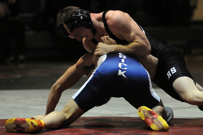 Jeff Kielien of Roosevelt High School grapples with Josh Martinez of Frederick High School during the 145-pound bout of a meet Thursday night at Roosevelt High School. Kielien won in a 6-0 decision.