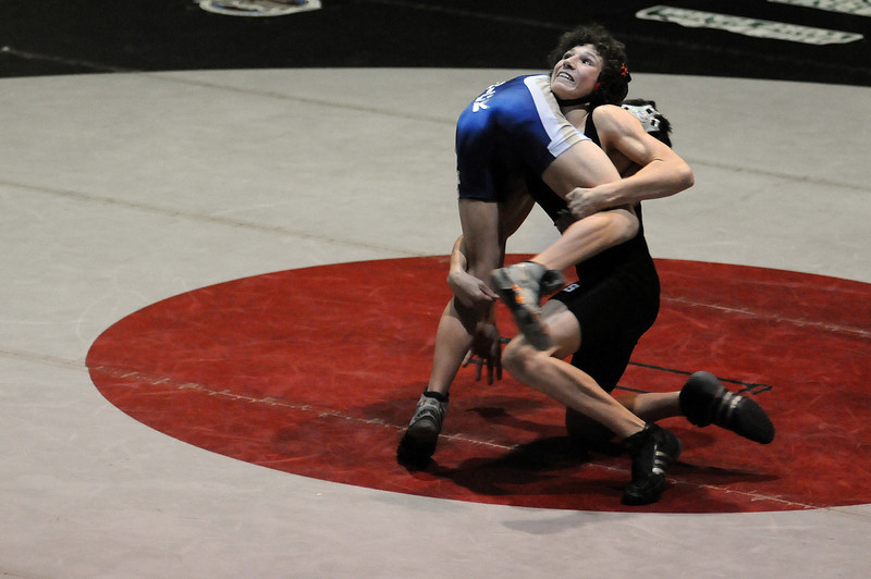 Jace Lopez of Roosevelt throws his opponent, Mike Ashton, during the 112-pound bout of a meet Thursday night at Roosevelt High School. Lopez won in a 9-3 decision.